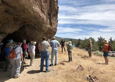 Giving a tour at Connley Caves, an archaeological site in Oregon's high desert.