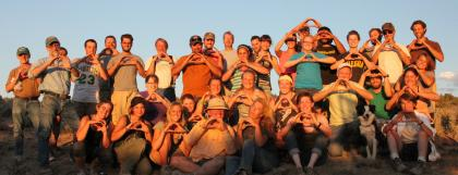"Group of field school students throwing the ""O"" hand sign"