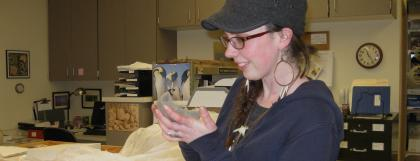 Student looking at an artifact