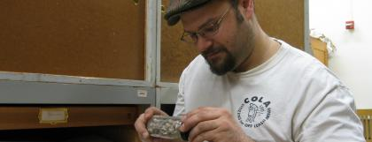 Student looking at a fossil in the paleontology collections