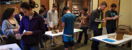 UO students complete an assignment with basketry materials from the museum's collection.