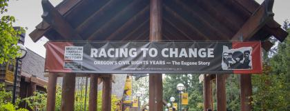 Racing to Change exterior banner